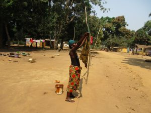The Water Project:  Woman Hanging Clothes