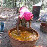 The Water Project: Lokomasama, Satamodia Village -  Woman Processing Palm Oil