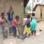 The Water Project: Kamasondo, Masinneh Village -  Children Pounding Rice