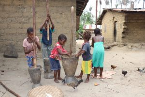 The Water Project:  Children Pounding Rice