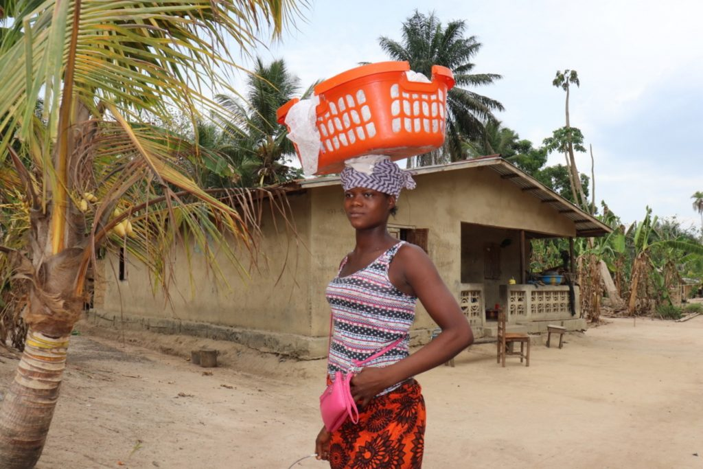The Water Project : sierraleone20424-woman-carries-goods-for-selling
