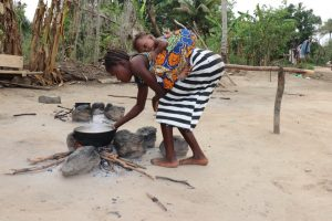 The Water Project:  Young Lady Cooking Food