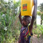 The Water Project: Lokomasama, Kennenday Village -  Small Boy Carrying Water