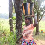 The Water Project: Lokomasama, Kennenday Village -  Woman Carrying Water