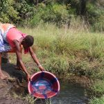 The Water Project: Lokomasama, Kennenday Village -  Woman Collecting Water