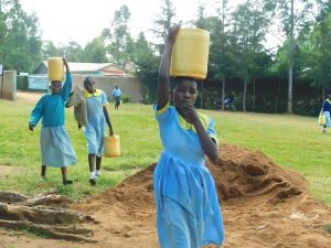 The Water Project:  Students Bring Water For Construction