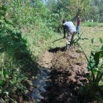 The Water Project: Mubinga Community, Mulutondo Spring -  Digging Drainage Channel