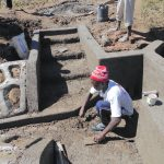 The Water Project: Kalenda A Community, Webo Simali Spring -  Cementing The Floor