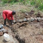 The Water Project: Musiachi Community, Mutuli Spring -  Backfilling With Stones