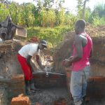 The Water Project: Kalenda B Community, Lumbasi Spring -  Setting The Pipe