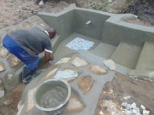 The Water Project:  Plastering Spring Floor