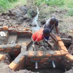 The Water Project: Emurumba Community, Makokha Spring -  Wall Construction