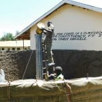 The Water Project: Hobunaka Primary School -  Filling Central Pillar With Cement