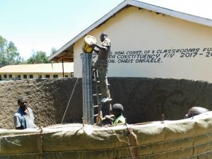 The Water Project:  Filling Central Pillar With Cement