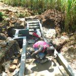 The Water Project: Namarambi Community, Iddi Spring -  Plaster Work