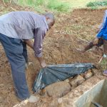 The Water Project: Musiachi Community, Mutuli Spring -  Soil Over Tarp And Stones
