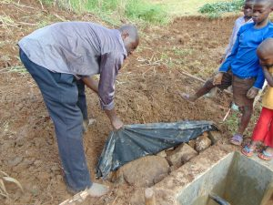 The Water Project:  Soil Over Tarp And Stones
