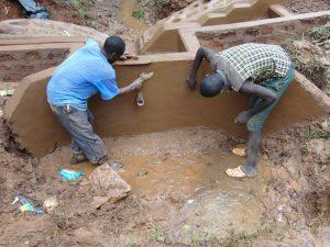The Water Project:  Plastering Inside Headwall