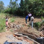 The Water Project: Mwichina Community, Matanyi Spring -  Delivering Stones For Backfilling
