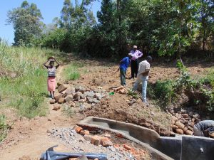 The Water Project:  Delivering Stones For Backfilling