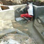 The Water Project: Namarambi Community, Iddi Spring -  Tile Setting