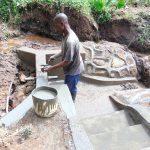 The Water Project: Maondo Community, Ambundo Spring -  Plastering