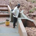 The Water Project: Kitulu Community, Kiduve Spring -  Plaster Work