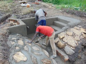 The Water Project:  Cementing Stone Pitching