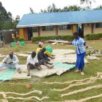 The Water Project: Sawawa Secondary School -  Community Helps Sew Sugar Sacks To Dome Wire