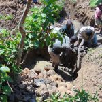 The Water Project: Mwichina Community, Matanyi Spring -  Backfilling