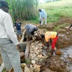 The Water Project: Namarambi Community, Iddi Spring -  Backfilling With Stones