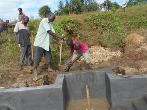 The Water Project:  Passing Clay To The Artisan
