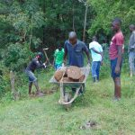 The Water Project: Mubinga Community, Mulutondo Spring -  Community Brings Stones For Backfill