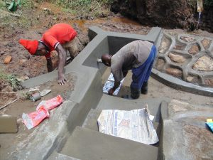 The Water Project:  Plastering And Setting Tiles