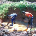 The Water Project: Imusutsu Community, Ikosangwa Spring -  Backfilling With Stones