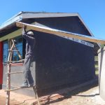 The Water Project: Chiliva Primary School -  Attaching Gutter To Dome