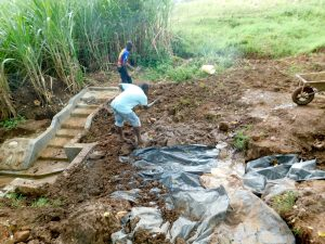 The Water Project:  Adding Tarp And Soil Over Stones