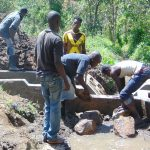 The Water Project: Mubinga Community, Mulutondo Spring -  Backfilling With Stones