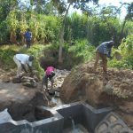 The Water Project: Kalenda B Community, Lumbasi Spring -  Backfilling With Stones