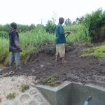 The Water Project: Bukhaywa Community, Shidero Spring -  Backfilling With Soil