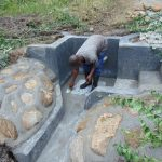 The Water Project: Emurumba Community, Makokha Spring -  Tile Setting