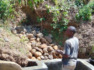 The Water Project:  Backfilled With Stones
