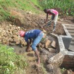 The Water Project: Kalenda A Community, Webo Simali Spring -  Backfilling With Stones