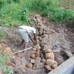 The Water Project: Maondo Community, Ambundo Spring -  Clay Works And Backfilling