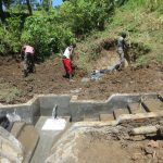 The Water Project: Rosterman Community, Lishenga Spring -  Soil Backfilling