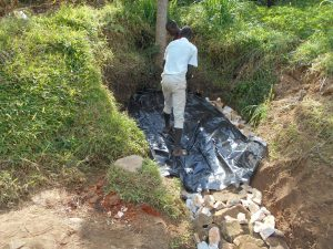 The Water Project:  Adding The Tarp Over Backfill