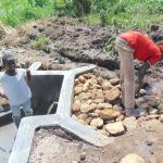 The Water Project: Emurumba Community, Makokha Spring -  Backfilling With Stones