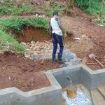 The Water Project: Imusutsu Community, Ikosangwa Spring -  Adding Tarp And Soil