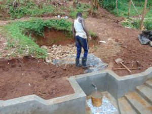 The Water Project:  Adding Tarp And Soil