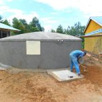 The Water Project: Sawawa Secondary School -  Leveling Ground Around Tank